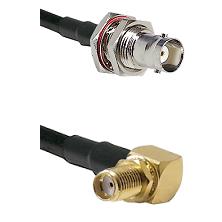 BNC Female Bulkhead on LMR-195-UF UltraFlex to SMA Right Angle Female Bulkhead Coaxial Cable Assembl