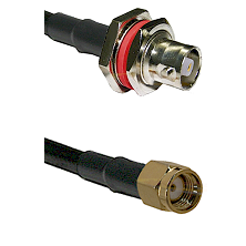 C Female Bulkhead on RG142 to SMA Reverse Polarity Male Cable Assembly