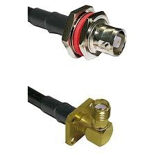 C Female Bulkhead on RG142 to SMA 4 Hole Right Angle Female Cable Assembly