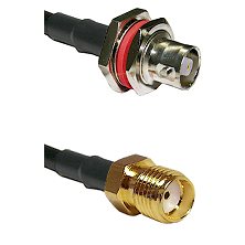 C Female Bulkhead on RG142 to SMA Reverse Thread Female Cable Assembly