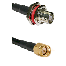 C Female Bulkhead on RG142 to SMA Reverse Thread Male Cable Assembly