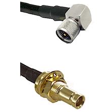 Mini-UHF Right Angle Male on LMR200 UltraFlex to 10/23 Female Bulkhead Cable Assembly