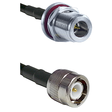 N Reverse Polarity Female Bulkhead on RG142 to C Male Cable Assembly