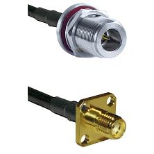 N Reverse Polarity Female Bulkhead on RG58 to SMA 4 Hole Female Cable Assembly