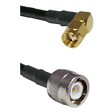 SMA Reverse Polarity Right Angle Male on RG142 to C Male Cable Assembly