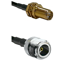 SMA Reverse Polarity Female Bulkhead on LMR100 to N Female Cable Assembly
