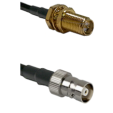 SMA Reverse Polarity Female Bulkhead on RG142 to C Female Cable Assembly