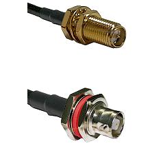 SMA Reverse Polarity Female Bulkhead on RG142 to C Female Bulkhead Cable Assembly