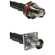TNC Reverse Polarity Female Bulkhead on LMR200 UltraFlex to C 4 Hole Female Cable Assembly