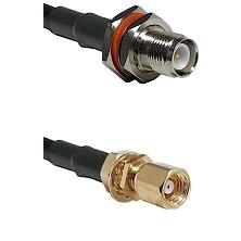 TNC Reverse Polarity Female Bulkhead on LMR200 UltraFlex to SMC Female Bulkhead Coaxial Cable Assemb