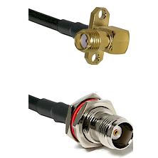 SMA 2 Hole Right Angle Female on LMR200 UltraFlex to TNC Female Bulkhead Cable Assembly