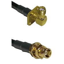 SMA 4 Hole Right Angle Female on LMR100 to MCX Female Bulkhead Cable Assembly