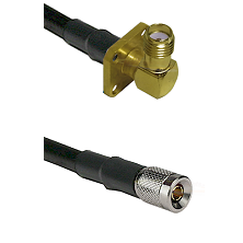 SMA 4 Hole Right Angle Female on LMR200 UltraFlex to 10/23 Male Cable Assembly