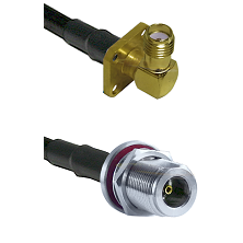 SMA 4 Hole Right Angle Female on LMR240 Ultra Flex to N Female Bulkhead Cable Assembly