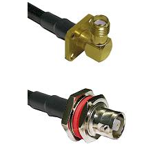 SMA 4 Hole Right Angle Female on RG142 to C Female Bulkhead Cable Assembly
