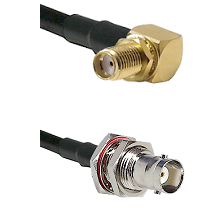 SMA Right Angle Female Bulkhead on LMR200 UltraFlex to BNC Female Bulkhead Cable Assembly
