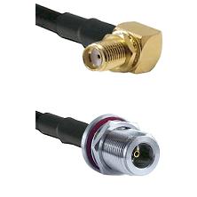 SMA Reverse Thread Right Angle Female Bulkhead on LMR100 to N Female Bulkhead Cable Assembly