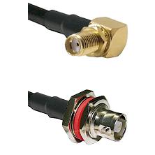 SMA Reverse Thread Right Angle Female Bulkhead on RG142 to C Female Bulkhead Cable Assembly