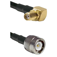 SMA Reverse Thread Right Angle Female Bulkhead on RG142 to C Male Cable Assembly