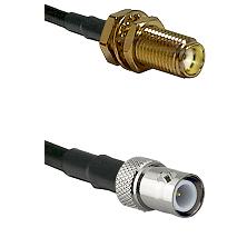 SMA Female Bulkhead on LMR-195-UF UltraFlex to BNC Reverse Polarity Female Cable Assembly