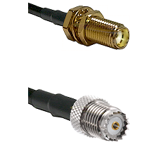 SMA Female Bulkhead on RG142 to Mini-UHF Female Cable Assembly