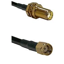 SMA Female Bulkhead on RG188 to SMA Reverse Polarity Male Cable Assembly