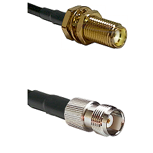 SMA Female Bulkhead on RG188 to TNC Female Cable Assembly